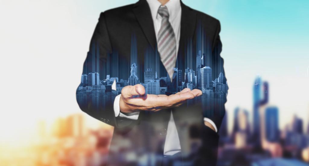 man holding a transparent skyline